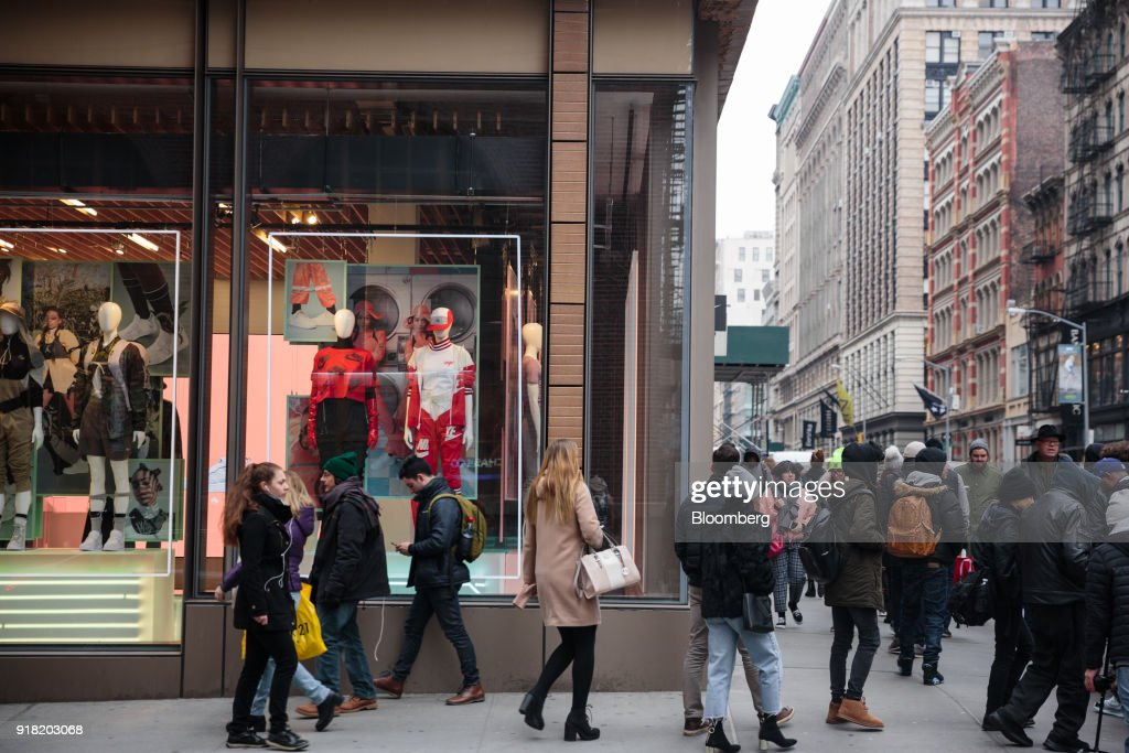 Pedestrians pass in front of a Nike Inc. store in the SoHo neighborhood of New York, U.S., on Friday, Feb. 9, 2018. Bloomberg is scheduled to release consumer comfort figures on February 15. Photographer: Sarah Blesener/Bloomberg via Getty Images