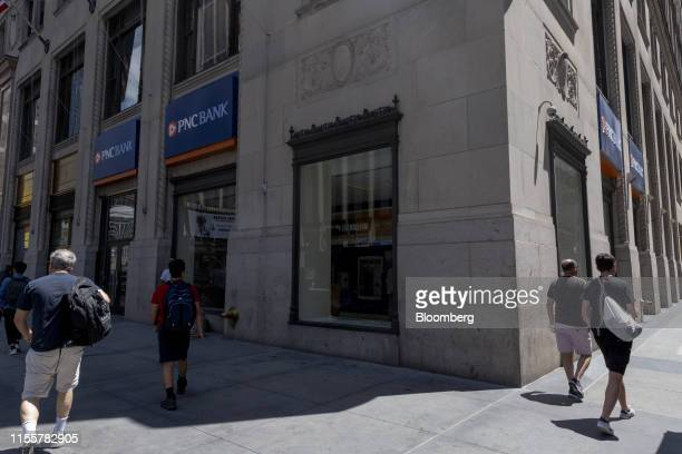Pedestrians pass in front of a PNC Financial Services Group Inc bank branch in New York US on Saturday July 13 2019 PNC Financial Services Group Inc...