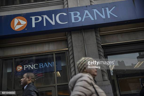 Pedestrians pass in front of a PNC Financial Services Group Inc bank branch in New York US on Monday Jan 9 2017 PNC Financial Services Group Inc is...