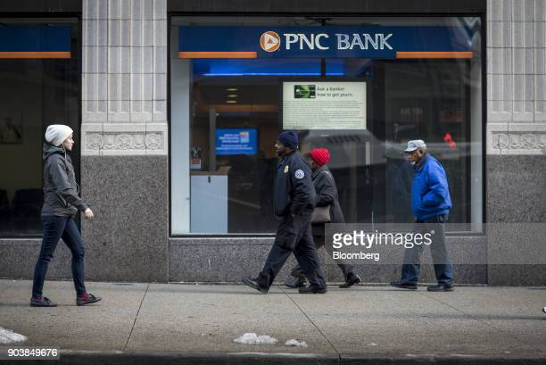 Pedestrians pass in front of a PNC Financial Services Group Inc bank branch in downtown Chicago Illinois US on Monday Jan 8 2018 PNC Financial...
