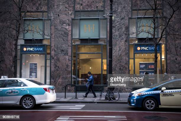 Pedestrians pass in front of a PNC Financial Services Group Inc bank branch in downtown Chicago Illinois US on Tuesday Jan 9 2018 PNC Financial...