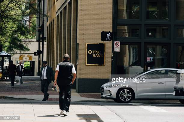 Pedestrians pass in front of a PNC Financial Services Group Inc bank branch in Birmingham Alabama US on Wednesday April 11 2018 PNC Financial...