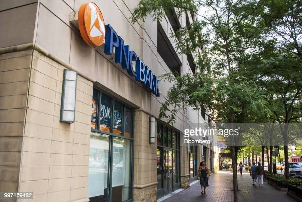 Pedestrians pass in front of a PNC Financial Services Group Inc bank branch in Chicago Illinois US on Wednesday July 11 2018 PNC Financial Services...