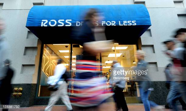 Pedestrians pass in front of a Ross Stores Inc. Location in San Francisco, California, U.S., on Wednesday, Aug. 31, 2011. Ross Stores Inc. Is gaining...