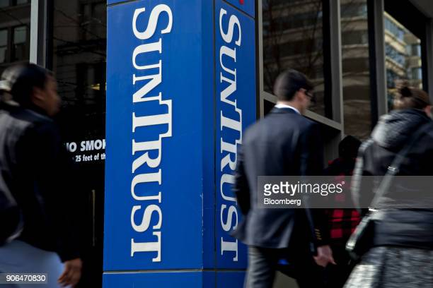 Pedestrians pass in front of a SunTrust Banks Inc branch in Washington DC US on Thursday Jan 11 2018 SunTrust Banks Inc is scheduled to release...