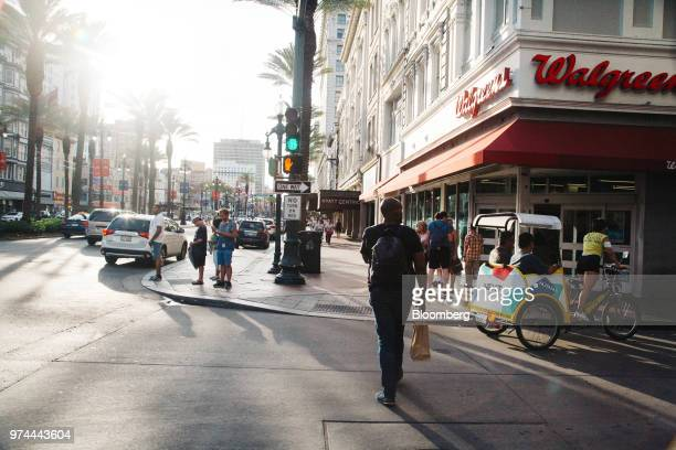 Pedestrians pass in front of a Walgreens Boots Alliance Inc. Location on Canal Street in New Orleans, Louisiana, U.S., on Wednesday, June 13, 2018....