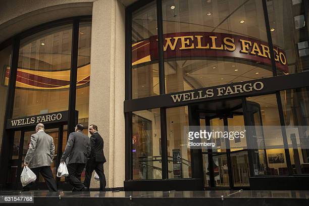 Pedestrians pass in front of a Wells Fargo Co bank branch in New York US on Wednesday Jan 11 2017 Wells Fargo Co is scheduled to release earning...