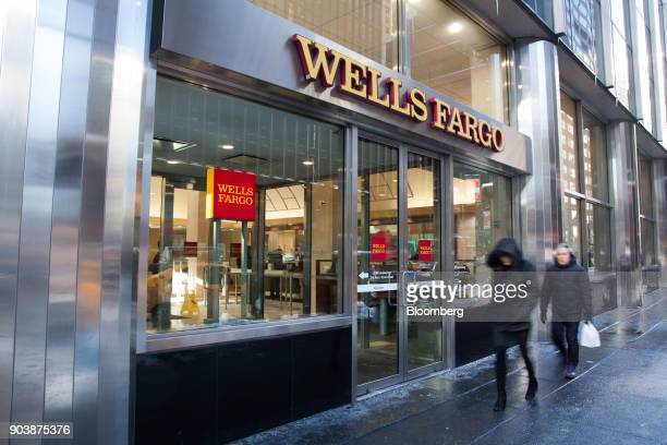Pedestrians pass in front of a Wells Fargo Co bank branch in New York US on Friday Jan 5 2018 Wells Fargo Co is scheduled to release earnings figures...