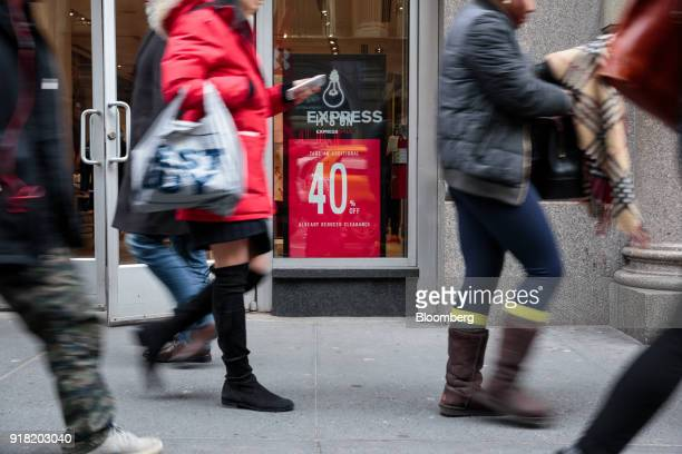 Pedestrians pass in front of an Express Inc store in the SoHo neighborhood of New York US on Friday Feb 9 2018 Bloomberg is scheduled to release...