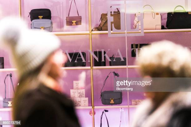 Pedestrians pass in front of an Ivanka Trump brand store at Trump Tower in New York US on Thursday Dec 14 2017 Trump's new store marks her second...
