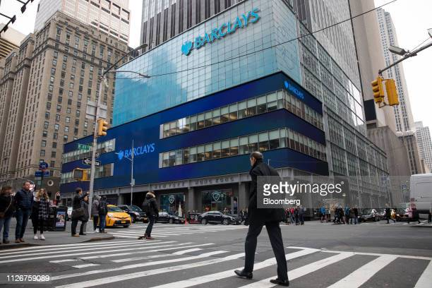 Pedestrians pass in front of Barclays PLC headquarters in New York US on Friday Feb 22 2019 US stocks rose along with Treasuries as investors awaited...