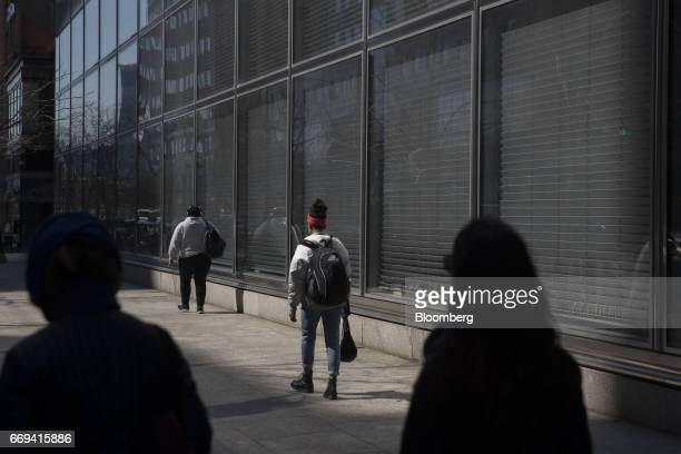 Pedestrians pass in front of Goldman Sachs Group Inc headquarters in New York US on Friday April 14 2017 The Goldman Sachs Group Inc is scheduled to...