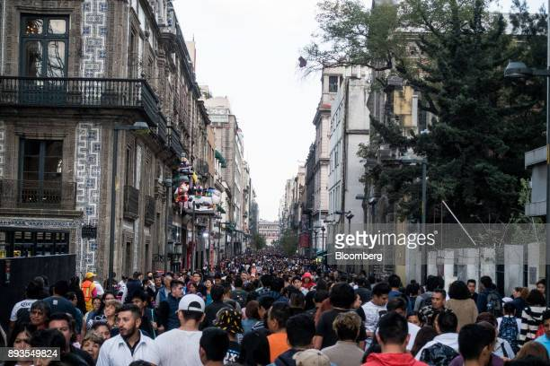 Pedestrians pass in front of Grupo Sanborns SAB department store in Mexico City Mexico on Monday Nov 20 2017 The National Institute of Statistics and...