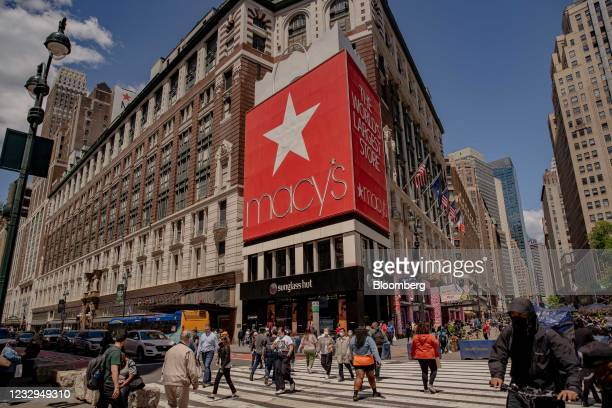 Pedestrians pass in front of Macy's Inc. Flagship department store in the Herald Square area of New York, U.S., on Thursday, May 13, 2021. Macy's...