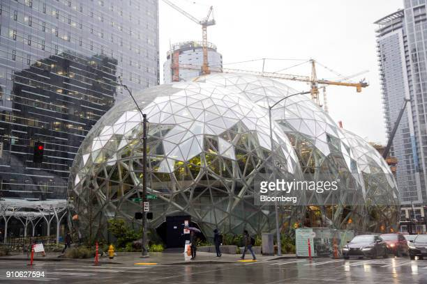 Pedestrians pass in front of the Amazoncom Inc Spheres in Seattle Washington US on Tuesday Jan 23 2018 The online retailer is scheduled to unveil the...