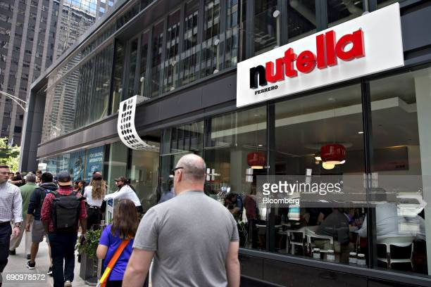 Pedestrians pass in front of the Ferrero SpA Nutella Cafe in Chicago Illinois US on Wednesday May 31 2017 Ferrero SpA opened its first owned and...