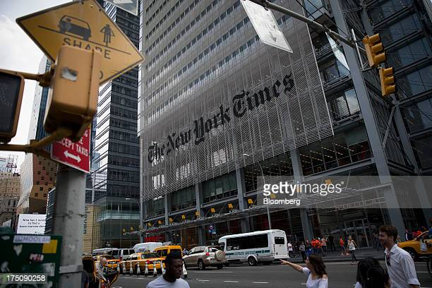 Pedestrians pass in front of The New York Times Co offices in New York US on Wednesday July 31 2013 The New York Times Co is scheduled to release...