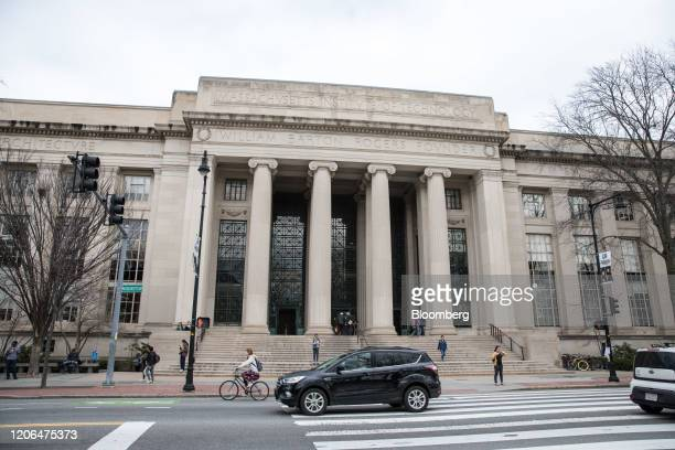 Pedestrians pass in front of the Rogers Building at the Massachusetts Institute of Technology campus in Cambridge Massachusetts US on Tuesday March...
