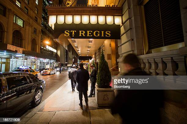 Pedestrians pass in front of The St Regis Hotel a Starwood Hotels Resorts Worldwide Inc property in New York US on Wednesday Oct 23 2013 Starwood...