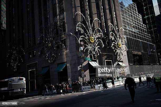 Pedestrians pass in front of the Tiffany Co flagship store on Fifth Avenue in New York US on Saturday Nov 26 2016 Tiffany Co is scheduled to release...