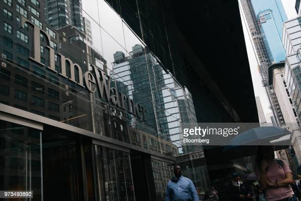 Pedestrians pass in front of the Time Warner Center in New York US on Wednesday June 13 2018 ATT Inc's sweeping court victory allowing its takeover...