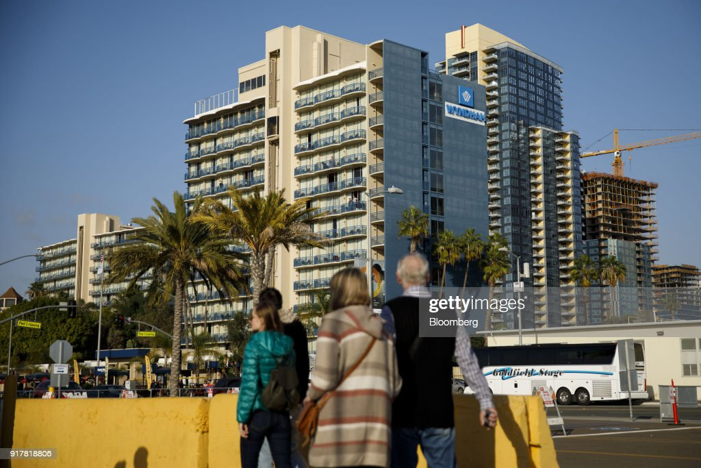 Pedestrians pass in front of the Wyndham San Diego Bayside hotel in San Diego, California, U.S., on Sunday, Feb. 11, 2018. Wyndham Worldwide Corp. is scheduled to release earnings figures on February 14. Photographer: Patrick T. Fallon/Bloomberg via Getty Images