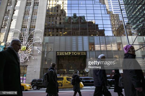 Pedestrians pass in front of Trump Tower in New York, U.S., on Wednesday, Dec. 19, 2018. In late November, Special CounselRobert Mueller secured a...