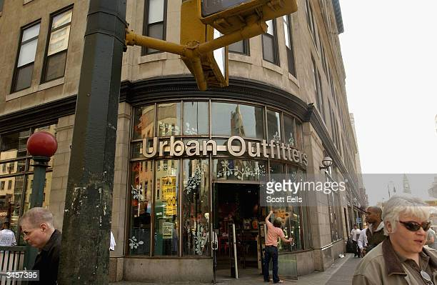Pedestrians pass in front of Urban Outfitters on 6th Ave and 14th street in Manhattan Urban Outfitters due to popular demand and high stock prices is...