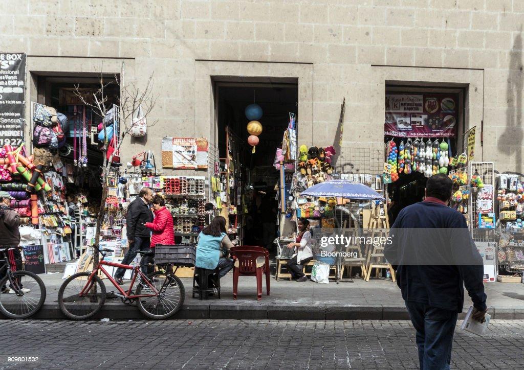 pedestrians pass in front of vendors along republica del salvador