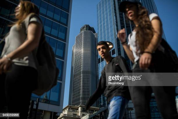 Pedestrians pass in view of Tower 42 in the City of London UK on Friday April 20 2018 Foreign investors are less worried about the impact of...