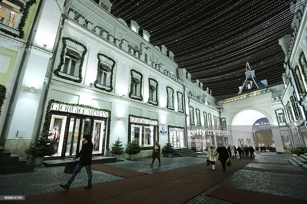 Pedestrians pass luxury boutique stores on Tretyakov Drive in Moscow, Russia, on Wednesday, Dec. 28, 2016. President-elect Donald Trump said Wednesday that the U.S. should move on rather than retaliate against Russia for interfering in the 2016 election, with the Obama administration expected to soon take action against Moscow. Photographer: Andrey Rudakov/Bloomberg via Getty Images