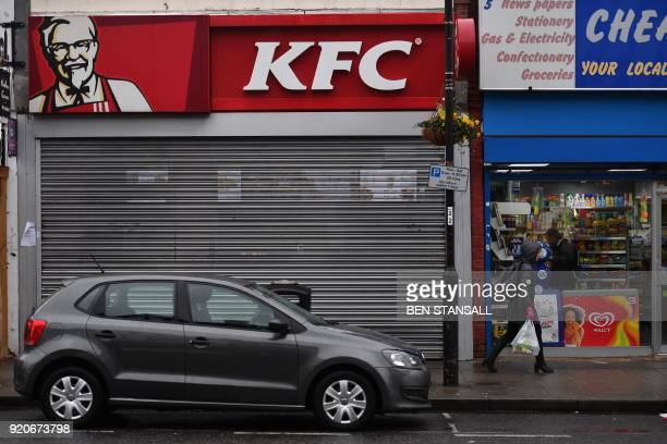 Pedestrians pass outside a closed KFC fast food store in south London on February 19 2018 US fast food chain KFC said on February 19 it had been...