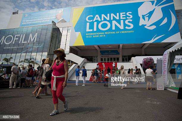 Pedestrians pass outside the Cannes Congress Center during the Cannes Lions International Festival Of Creativity in Cannes France on Tuesday June 17...