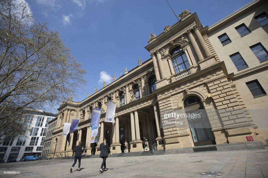 Pedestrians pass outside the Frankfurt Stock Exchange, operated by Deutsche Boerse AG, in Frankfurt, Germany, on Monday, April 16, 2018. Bonds declined, stocks were steady and oil fell on anticipation that the fallout from missile strikes in Syria will be limited. Photographer: Alex Kraus/Bloomberg via Getty Images