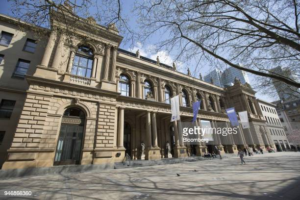 Pedestrians pass outside the Frankfurt Stock Exchange operated by Deutsche Boerse AG in Frankfurt Germany on Monday April 16 2018 Bonds declined...