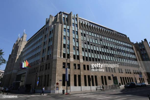 Pedestrians pass outside the headquarters of Ageas in Brussels Belgium on Thursday July 26 2018 Fosun International Ltd the Chinese group backed by...