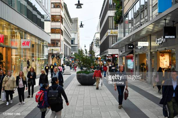 Pedestrians pass shops on Drottninggatan in Stockholm, Sweden, on Monday, Sept. 21, 2020. Finance Minister Magdalena Andersson said Swedens fiscal...