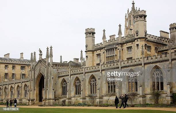 Pedestrians pass St John's College part of the University of Cambridge in Cambridge UK on Friday March 22 2013 In 2011 the UK's government unveiled a...