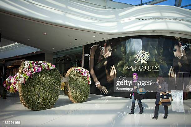 Pedestrians pass stores in the VIP zone where the luxury brands are located inside the Morocco Mall in Casablanca Morocco on Friday Jan 20 2012...