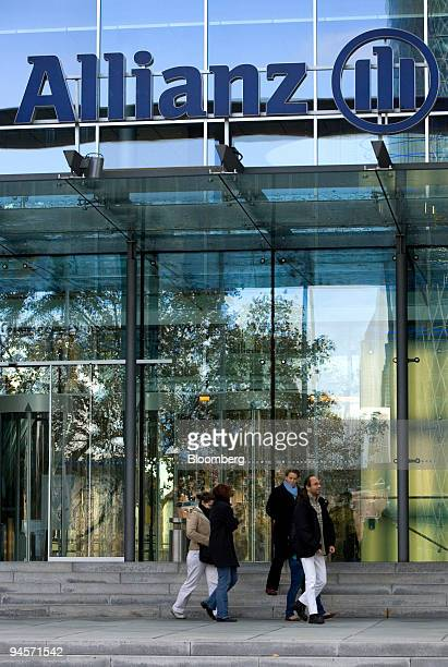 Pedestrians pass the Allianz offices in Frankfurt Germany on Friday Nov 9 2007 Allianz SE Europe's biggest insurer reported a 21 percent increase in...