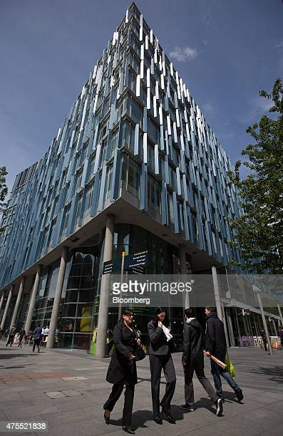 Pedestrians pass the Blue Fin building owned by Time Inc center on Southwark Street in London UK on Monday June 1 2015 Time Inc the magazine...