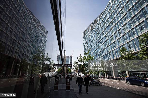 Pedestrians pass the Blue Fin building owned by Time Inc right on Southwark Street in London UK on Monday June 1 2015 Time Inc the magazine publisher...