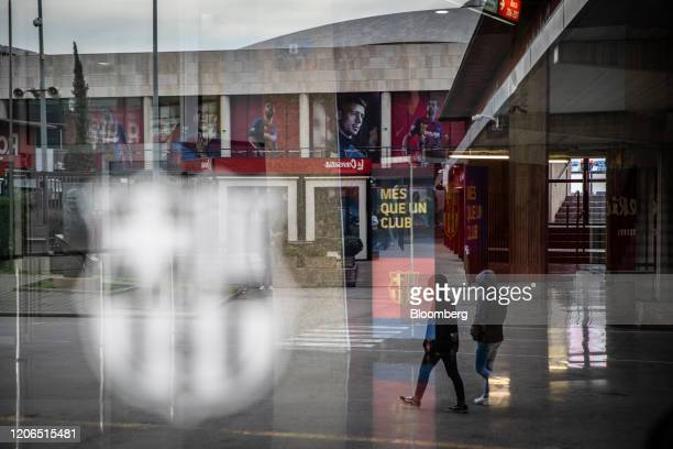 Pedestrians pass the Camp Nou stadium home to FC Barcelona in Barcelona Spain on Tuesday March 10 2020 Spains economy is particularly vulnerable to...