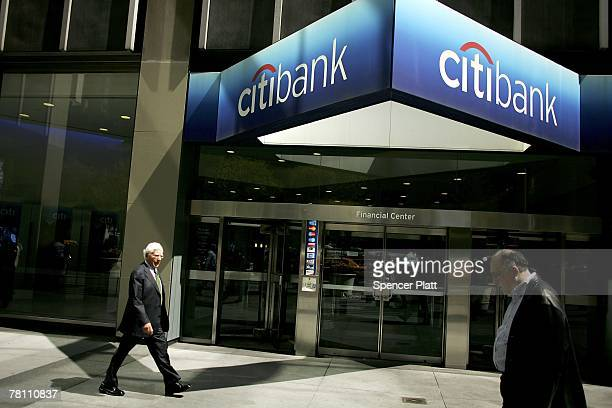 Pedestrians pass the Citibank building April 17, 2006 in New York City. Citigroup announced late on November 26, 2007 that it had sold a $7.5 billion...