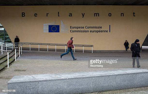 Pedestrians pass the Council of the European Union's Berlaymont building in Brussels Belgium on Tuesday Jan 27 2015 European Union plans to ban...