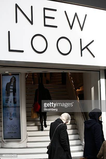 Pedestrians pass the entrance to New Look fashion store operated by New Look Group Ltd on Oxford Street in London UK on Friday Feb 13 2015 Apax...