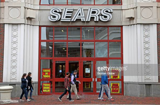 Pedestrians pass the entrance to the closing Sears store at the CambridgeSide Galleria in Cambridge, MA on Oct. 15, 2018. Signs for a...
