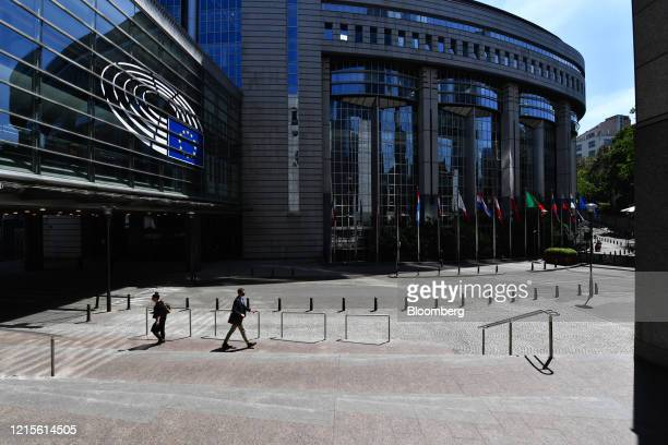 Pedestrians pass the European Parliament's Paul-Henri Spaak building in Brussels, Belgium, on Wednesday, May 27, 2020. The European Unions executive...
