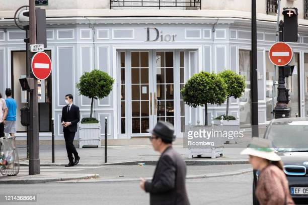 Pedestrians pass the founding Christian Dior SE luxury goods store operated by LVMH Moet Hennessy Louis Vuitton SE on Avenue Montaigne in Paris...