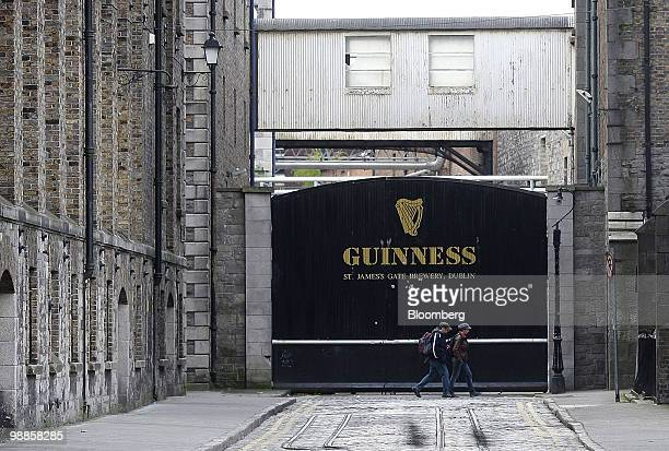 Pedestrians pass the gates of the Guinness brewery at St James's Gate in Dublin Ireland on Tuesday May 4 2010 European Union Economic and Monetary...